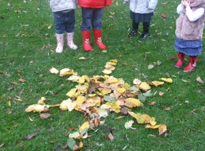 Image of a sunshine created by the children out of leaves